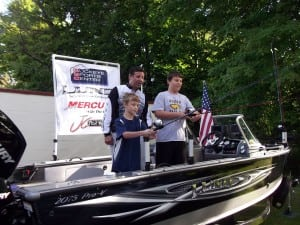 John Csizmadia assists young anglers during  a TWF Reel Kids casting competition. Photo Credit: Kay Csizmadia